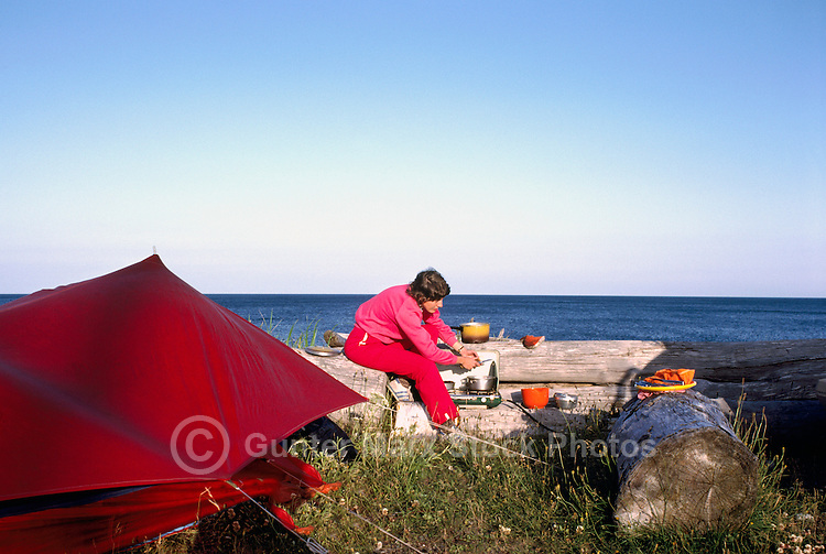 Haida Gwaii (Queen Charlotte Islands), Northern BC, British Columbia, Canada - Camper cooking a Meal at Agate Beach Campground along McIntyre Bay, Naikoon Provincial Park, Graham Island (Model Released)