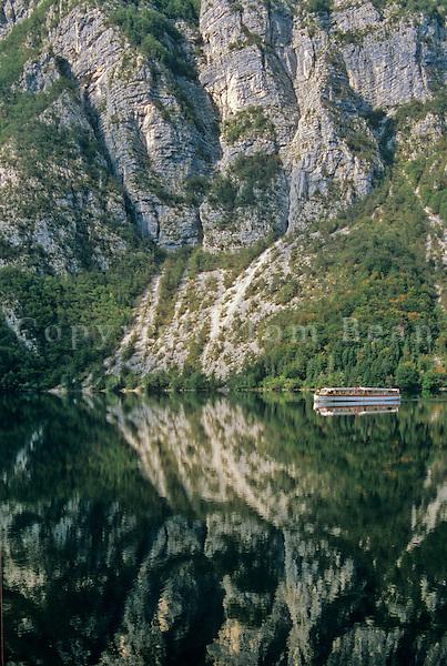 Tour boat cruising on Lake Bohinj, mirror-like reflection of mountains, Triglav National Park, Slovenia, AGPix_0560   .