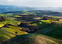 Sunlight shining on Valley in Tuscany, Italy