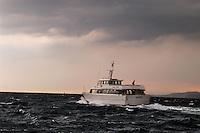 - tourist boat in navigation with stormy sea....- battello turistico in navigazione con mare in tempesta