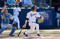 Jake Jefferies #4 of the Cal State Fullerton Titans bats in front of Shane Zeile #14 of the UCLA Bruins during the NCAA Super Regional at Goodwin Field on June 7, 2013 in Fullerton, California. UCLA defeated Cal State Fullerton, 5-3. (Larry Goren/Four Seam Images)