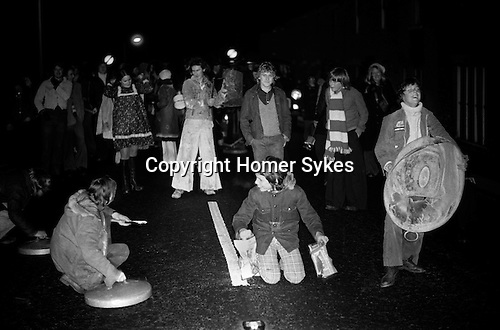 Tin Can Band Broughton Northamptonshire UK 1974.<br /> Annually in December, locals in the rural village of Broughton drive out evil spirits by creating as much noise as possible while walking around and marking the Parish boundaries.
