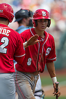 North Carolina State shortstop Trea Turner (8) is greeted at home by teammate Grant Clyde (22) after scoring in the first inning of Game 3 of the 2013 Men's College World Series between the North Carolina State Wolfpack and North Carolina Tar Heels at TD Ameritrade Park on June 16, 2013 in Omaha, Nebraska. The Wolfpack defeated the Tar Heels 8-1. (Andrew Woolley/Four Seam Images)