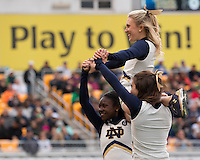 Members of the Notre Dame cheerleading squad perform during the game. The Notre Dame Fighting Irish football team defeated the Pitt Panthers 42-30 on Saturday, November 7, 2015 at Heinz Field, Pittsburgh, Pennsylvania.