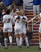 Boston College forward Kristen Mewis (19) celebrates her goal with teammates. Boston College defeated Hofstra University, 3-1, in second round NCAA tournament match at Newton Soccer Field, Newton, MA.