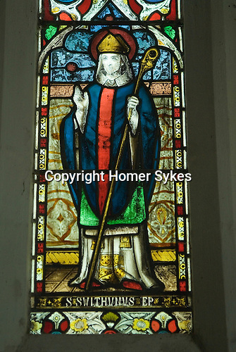 Stained glass window above alter depicting Saint Swithun.  St Swithuns Church, Headbourne Worthy, Hampshire, Uk.  Saxon and earlier. 2012 2010s