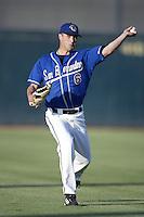 Derrick Van Dusen of the San Bernardino Stampede warms up before  pitching during a California League 2002 season game at San Manuel Stadium, in San Bernardino, California. (Larry Goren/Four Seam Images)
