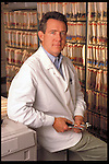portrait of male doctor and medical records
