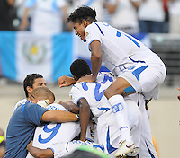 Honduras Carlos Costly (13) jumps with teammates to celebrate the victory.   Honduras defeated Costa Rica in Penalty Kick 4-2 in the quaterfinals for the 2011 CONCACAF Gold Cup , at the New Meadowlands Stadium, Saturday June 18, 2011.