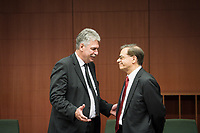 Austrian Finance Minister Hans Jorg  Schelling talks with Greek Finance Minister Gikas Chardouvelis   at the start of a Eurogroup with European Finance Ministers meeting at EU council headquarters in Brussels, Belgium on 26.01.2015 The Eurogroup's meeting focus on Greece, after  leftist anti-bailout party SYRIZA won parliamentary elections by Wiktor Dabkowski