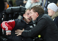 SWANSEA, WALES - MARCH 16: Liverpool manager Brendan Rodgers (R) greets a young Swansea supporter prior to the Premier League match between Swansea City and Liverpool at the Liberty Stadium on March 16, 2015 in Swansea, Wales