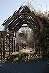February 2, 2012. Hillsborough, NC.. A view through the trellis in one of the sculpted gardens..  Nancy Goodwin, who used to run a mail order nursery for rare bulbs, has now preserved her gardens, which in winter, have thousands of blooming flowers and plants, including many rare species which she has cultivated and planted from seeds.