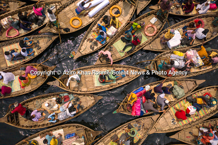 "GUSH HOUR..... A busy waterway is filled with boats and their passengers in the morning commute as they try to pass on a river in Bangladesh. <br /> <br /> Azim Khan Ronnie pictured the boats on the Buriganga River in Bangladesh as millions of commuters attempt to cross the river daily to get to their workplace in the city of Dhaka.  The Bangladeshi capital is one of the most densely populated in the world and home to around 19 million people.<br /> <br /> Azim said ""The waterway is quite busy in the morning as people try to get to the office and to work on time.  Some wear masks, but people don't see Covid-19 as an issue here anymore but Covid cases are increasing day by day quite rapidly.""<br /> <br /> ""Boats are the only way to cross this waterway so people pass rivers with these boats even with the risk of catching Covid.   Our country has not been shutdown like in the UK but has many restrictions in place to reduce the spread of Covid-19 but sadly people here can't maintain it."" <br /> <br /> Please byline: Azim Khan Ronnie/Solent News<br /> <br /> © Azim Khan Ronnie/Solent News & Photo Agency<br /> UK +44 (0) 2380 458800"