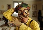 Milano, 2000 circa, Dario Fo nella sua casa mostra la collezione di antiche maschere da teatro italiane, Milan, about 2000, Dario Fo is his home, showing his collection of ancient Italian theater masks