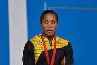 Alia Atkinson of JAM during award ceremony for 100 meter breaststroke final during Commonwealth Games Swimming, Monday, July 28, 2014 in Glasgow, United Kingdom. (Mo Khursheed/TFV Media via AP Images)