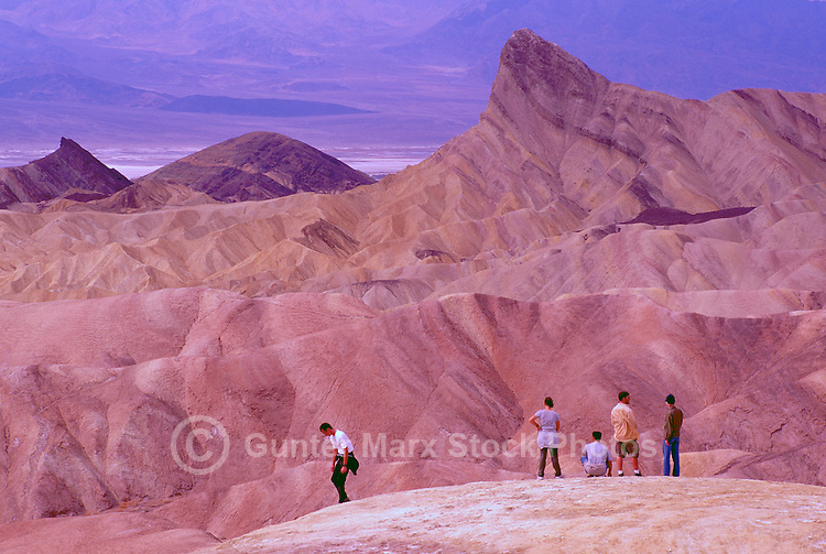 Death Valley National Park, California, CA, USA - Tourists looking at 'Manly Beacon' and Eroded Landscape, from Zabriskie Point in the Amargosa Range