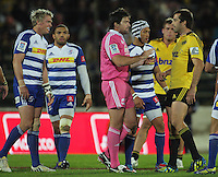 Referee Steve Walsh (centre) calms the situation as captain Jean De Villiers (left) and Conrad Smith (right) look on during the Super Rugby match between the Hurricanes and Stormers at FMG Stadium, Palmerston North, New Zealand on Friday, 26 April 2013. Photo: Dave Lintott / lintottphoto.co.nz
