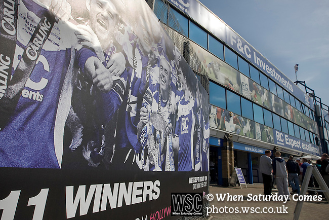 Birmingham City 1 Wolverhampton Wanderers 1, 01/05/2011. St Andrews, Premier League. A poster of the 2011 League Cup winning team on display outside the Spion Kop stand at St. Andrew's stadium with the city's skyline in the distance, prior to Birmingham City's Barclay's Premier League match with Wolverhampton Wanderers. Both clubs were battling against relegation from  England's top division. The match ended in a 1-1 draw, watched by a crowd of 26,027. Photo by Colin McPherson.