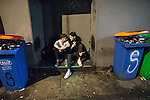 """© Joel Goodman - 07973 332324 . 17/12/2016 . Manchester , UK . Two men sit in a doorway in an alleyway off Peter Street . Revellers out in Manchester City Centre overnight during """" Mad Friday """" , named for being one of the busiest nights of the year for the emergency services in the UK . Photo credit : Joel Goodman"""