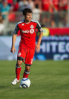 Toronto FC midfielder Nathan Sturgis #11 in action during an MLS game between the Seattle Sounders FC and the Toronto FC at BMO Field in Toronto on June 18, 2011..The Seattle Sounders FC won 1-0.