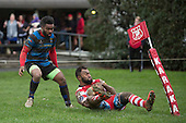 Reggie Sikivou can only watch as Vuga Tagicakibau slides in to touch after securing the chip kick that was meant for him. Counties Manukau Premier Club Rugby game between Karaka and Onewhero, played at Karaka on Saturday June 25th 2016. Karaka won the game 15 - 10 after leading 10 - 3 at halftime.<br />  Photo by Richard Sprnger.