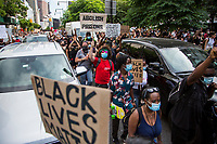 NEW YORK, NEW YORK - June 19: Hundreds of protesters roll cars before crossing the Brooklyn Bridge on June 19, 2020. People gathered in New York at different locations to celebrate June 15, which remembers the day in 1865. When Union soldiers freed slaves, all movements are celebrated in the context of protests against the murder of George Floyd and other African Americans by the police in the USA. (Photo by Pablo Monsalve / VIEWpress via Getty Images)