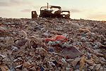 Landfill, garbage mound, bulldozer, Snohomish River Delta, Marysville, Washington State, Pacific Northwest, this dump has been capped but is leaching into the Snohomish River and Puget Sound