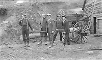 Group of men demonstrating the use of a fire hose reel, ca. 1920, Alberta or Saskatchewan. From the Godby Family fonds,