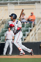 Kyri Washington (21) of the Greenville Drive follows through on his swing against the Kannapolis Intimidators at Intimidators Stadium on June 7, 2016 in Kannapolis, North Carolina.  The Drive defeated the Intimidators 4-1 in game one of a double header.  (Brian Westerholt/Four Seam Images)