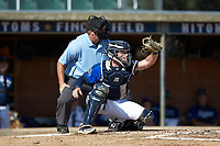 Martinsville Mustangs catcher Matthew Suggs (1) (UNC Wilmington) receives a pitch as home plate umpire Brian Pitts looks on during the game against the High Point-Thomasville HiToms at Finch Field on July 26, 2020 in Thomasville, NC.  The HiToms defeated the Mustangs 8-5. (Brian Westerholt/Four Seam Images)
