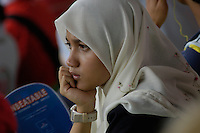 MUSLIM SPECTATORS AT THE F1 GRAND PRIX  SEPANG MALAYSIA MARCH 2008, FORMULA 1 WINNER IN SEPANG MALAYSIA WAS KIMMI RAIKKONEN IN HIS FERRARI FIRST PLACE, SECOND PLACE WENT TO ROBERT KUBICA IN HIS BMW-SAUBER, THIRD PLACE WENT TO HEIKKI KOVALAINEN IN A MCLAREN.