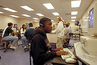 High school student at computer in science classroom. High School student at computer. Rio Rancho New Mexico USA.