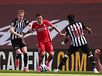 24th April 2021; Anfield, Liverpool, Merseyside, England; English Premier League Football, Liverpool versus Newcastle United; Roberto Firmino of Liverpool takes on Sean Longstaff and Allan Saint-Maximin of Newcastle United