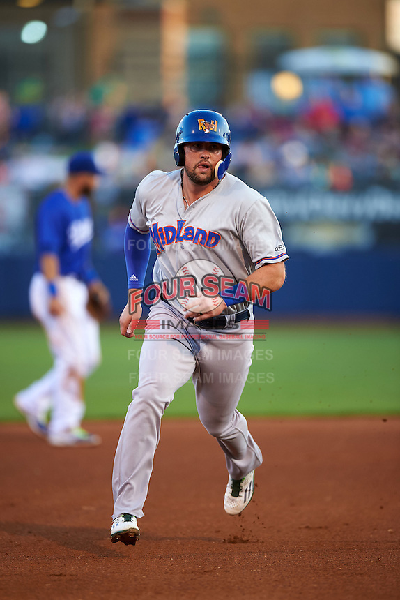 Midland RockHounds outfielder Josh Whitaker (26) running the bases  during a game against the Tulsa Drillers on June 2, 2015 at Oneok Field in Tulsa, Oklahoma.  Midland defeated Tulsa 6-5.  (Mike Janes/Four Seam Images)