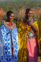 Tanzania. Maasai Village of Ololosokwan, Northern Serengeti.  Women Villagers Wearing Traditional Dress.