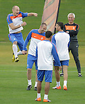 Arjen Robben of the Netherlands national soccer team(L) reacts while coach Bert van Marwijk(R) looks on during a soccer training session in the Princess Magogo stadium in the township of Kwamashu in Durban June 27, 2010.REUTERS/Michael Kooren (SOUTH AFRICA) ...