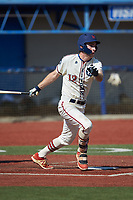 Greg Hardison (12) (UNCG) of the High Point-Thomasville HiToms follows through on his swing against the Old North State League West All-Stars at Hooker Field on July 11, 2020 in Martinsville, VA. The HiToms defeated the Old North State League West All-Stars 12-10. (Brian Westerholt/Four Seam Images)