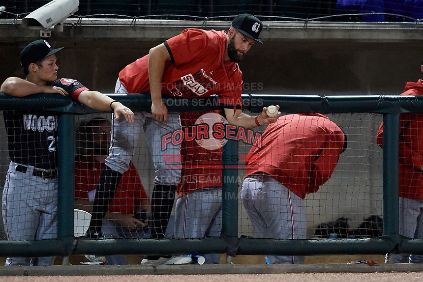 Chattanooga Lookouts pitcher Tyler Jay barehands a foul ball as Brantley Bell looks on during a Southern League game against the Birmingham Barons on May 1, 2019 at Regions Field in Birmingham, Alabama.  Chattanooga defeated Birmingham 5-0.  (Mike Janes/Four Seam Images)