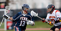 Michael Shakespeare (10) of Maryland tries to stop the progress of  John Conneely (13) of Penn at Ludwig Field in College Park, Maryland.