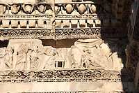 Rome, Fora: In foreground, one of the bas-relief among the ones that lie on the top of the so-called Colonnacce, the ancient Roman columns  that decorated the surrounding wall of the Forum of the emperor Nerva (I century AD). It was a sunny day and the white marble is enlightened.