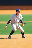 Shortstop Danny Poplawski #25 of the Georgetown Hoyas on defense against the Delaware State Hornets at Gene Hooks Field on February 26, 2011 in Winston-Salem, North Carolina.  Photo by Brian Westerholt / Four Seam Images