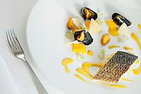 Mediterranean sea bass served withsaffron sauce and mussels[Loup de la mediterranée, sauce safran et moules de bouchon] at restaurant Mirazur, Menton, France, 18 September 2013