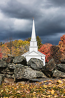 Charming New England church and stone wall in the village of Canterbury, New Hampshire, USA