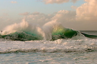 Waves crash into each other, causing a massive backwash explosion at Pipeline, on Oahu's North Shore.