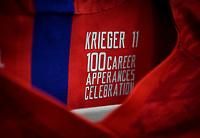 CHARLOTTE, NC - OCTOBER 03: Ali Krieger #11 of the United States celebrates her 100th cap during their game versus Korea Republic at Bank of American Stadium, on October 03, 2019 in Charlotte, NC.