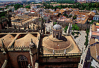 View from Giralda Tower looking over roof of cathedral Seville Spain.