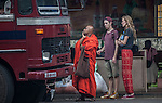 10 March 2015, Kandy, Sri Lanka: A buddhist monk waits for a bus with tourists outside the Central Market in Kandy, Central Province, Sri Lanka.  Kandy is the second largest city in the country after Colombo. It was the last capital of the ancient kings' era of Sri Lanka. The city lies in the midst of hills in the Kandy plateau, which crosses an area of tropical plantations, mainly tea. Kandy is both an administrative and religious city and is also the capital of the Central Province. Kandy is the home of The Temple of the Tooth Relic (Sri Dalada Maligawa), one of the most sacred places of worship in the Buddhist world. It was declared a world heritage site by UNESCO in  1988. Picture by Graham Crouch for the New York Times