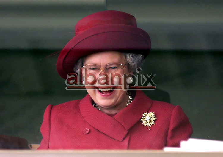 The Queen cheers on the horses as she watches the Newmarket races