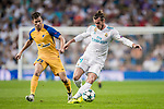 Gareth Bale (r) of Real Madrid fights for the ball with Agustin Farias of APOEL FC during the UEFA Champions League 2017-18 match between Real Madrid and APOEL FC at Estadio Santiago Bernabeu on 13 September 2017 in Madrid, Spain. Photo by Diego Gonzalez / Power Sport Images