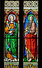 Saint Peter, left, and Saint Paul depicted in stained glass at the Basilica of the Sacred Heart